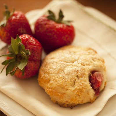 Closeup of strawberry cream scone