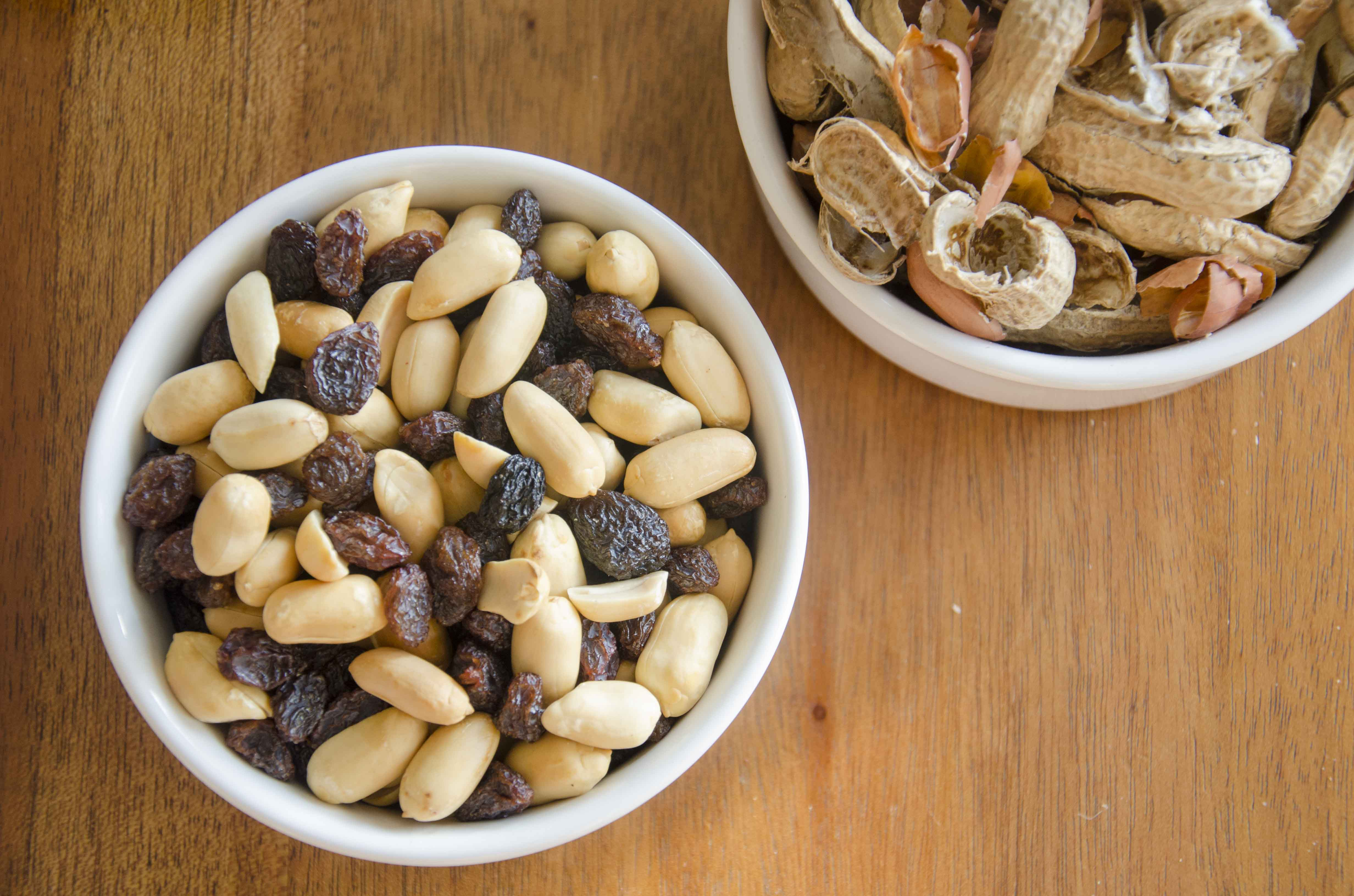 Roasted peanuts and raisins, peanut shells